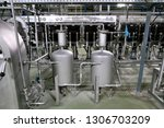 factory  for the production of... | Shutterstock . vector #1306703209