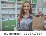 lovely mature red haired woman... | Shutterstock . vector #1306717999