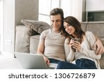 smiling young couple relaxing... | Shutterstock . vector #1306726879