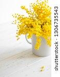bright bouquet of mimosa... | Shutterstock . vector #1306735543
