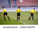 tree referees at soccer stadium ... | Shutterstock . vector #1306736359
