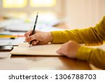 Small photo of Close up hand of business woman and business friend investment consultant analyzing studying company annual financial report balance sheet statement working with documents graphs laptop mobile phone