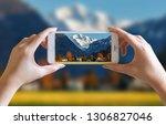 hands take photo of nice...   Shutterstock . vector #1306827046