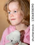 child with plush toy | Shutterstock . vector #1306858090