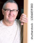 man is standing in the door | Shutterstock . vector #1306859383