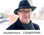 portrait of a senior with hat | Shutterstock . vector #1306859389
