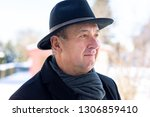 portrait of a senior with hat | Shutterstock . vector #1306859410