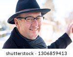 finger pointing of man with hat | Shutterstock . vector #1306859413