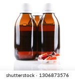 cough syrup isolated on white... | Shutterstock . vector #1306873576