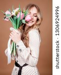 happy beautiful woman with...   Shutterstock . vector #1306924996