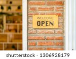 business open and welcome... | Shutterstock . vector #1306928179