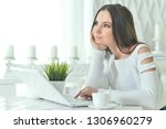portrait of young woman using... | Shutterstock . vector #1306960279