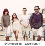 attractive family walking up to ... | Shutterstock . vector #130696874