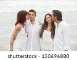 good looking family kissing... | Shutterstock . vector #130696880