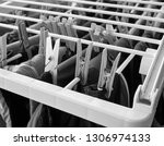 washed clothes on a drying rack | Shutterstock . vector #1306974133