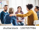men and women sitting in a... | Shutterstock . vector #1307057986
