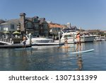 guy and girls stand up paddle...   Shutterstock . vector #1307131399
