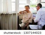 an elderly patient meeting... | Shutterstock . vector #1307144023