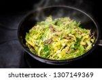 cooking green savoy cabbage...   Shutterstock . vector #1307149369