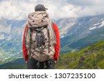 hiker traveling in alps. alpine ... | Shutterstock . vector #1307235100
