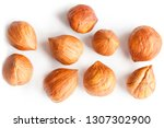 top view of shelled hazelnuts... | Shutterstock . vector #1307302900
