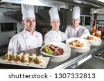 portrait of a chef with cooked... | Shutterstock . vector #1307332813