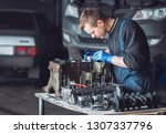 master collects a rebuilt motor ... | Shutterstock . vector #1307337796