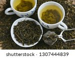 cup of green tea on pile of... | Shutterstock . vector #1307444839