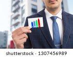 man holding card presenting...   Shutterstock . vector #1307456989