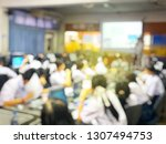 blurred image of group of... | Shutterstock . vector #1307494753