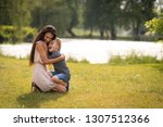 affectionate mother and son... | Shutterstock . vector #1307512366