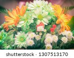 bouquet of white and orange... | Shutterstock . vector #1307513170