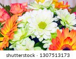 bouquet of white and orange... | Shutterstock . vector #1307513173