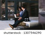 two business people sitting on... | Shutterstock . vector #1307546290