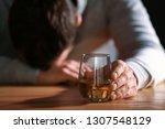 unconscious drunk man with... | Shutterstock . vector #1307548129