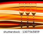 A Row Of Three Empty Champagne...