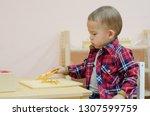 cute little boy in the...   Shutterstock . vector #1307599759