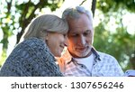 mature couple watching family... | Shutterstock . vector #1307656246