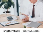 cropped view of businessman... | Shutterstock . vector #1307668303