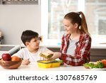 mother packing school lunch for ... | Shutterstock . vector #1307685769