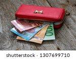 red female wallet full of euro... | Shutterstock . vector #1307699710