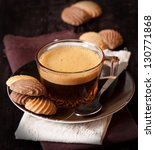 Cup of fresh coffee and cookies on a napkin. - stock photo