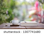 white cup with diary notebook... | Shutterstock . vector #1307741680