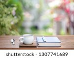 white cup with diary notebook... | Shutterstock . vector #1307741689