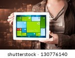 young lady holding tablet with... | Shutterstock . vector #130776140