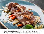 grilled veal steak with nuts... | Shutterstock . vector #1307765773