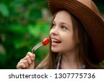 cute smiling little girl with... | Shutterstock . vector #1307775736