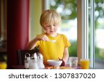 little boy eating healthy... | Shutterstock . vector #1307837020