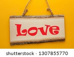 love word on wooden sign...   Shutterstock . vector #1307855770