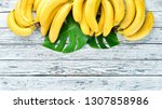 banana with green leaves on a... | Shutterstock . vector #1307858986